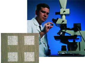 Man with microscope with inset photo of composites microstructure